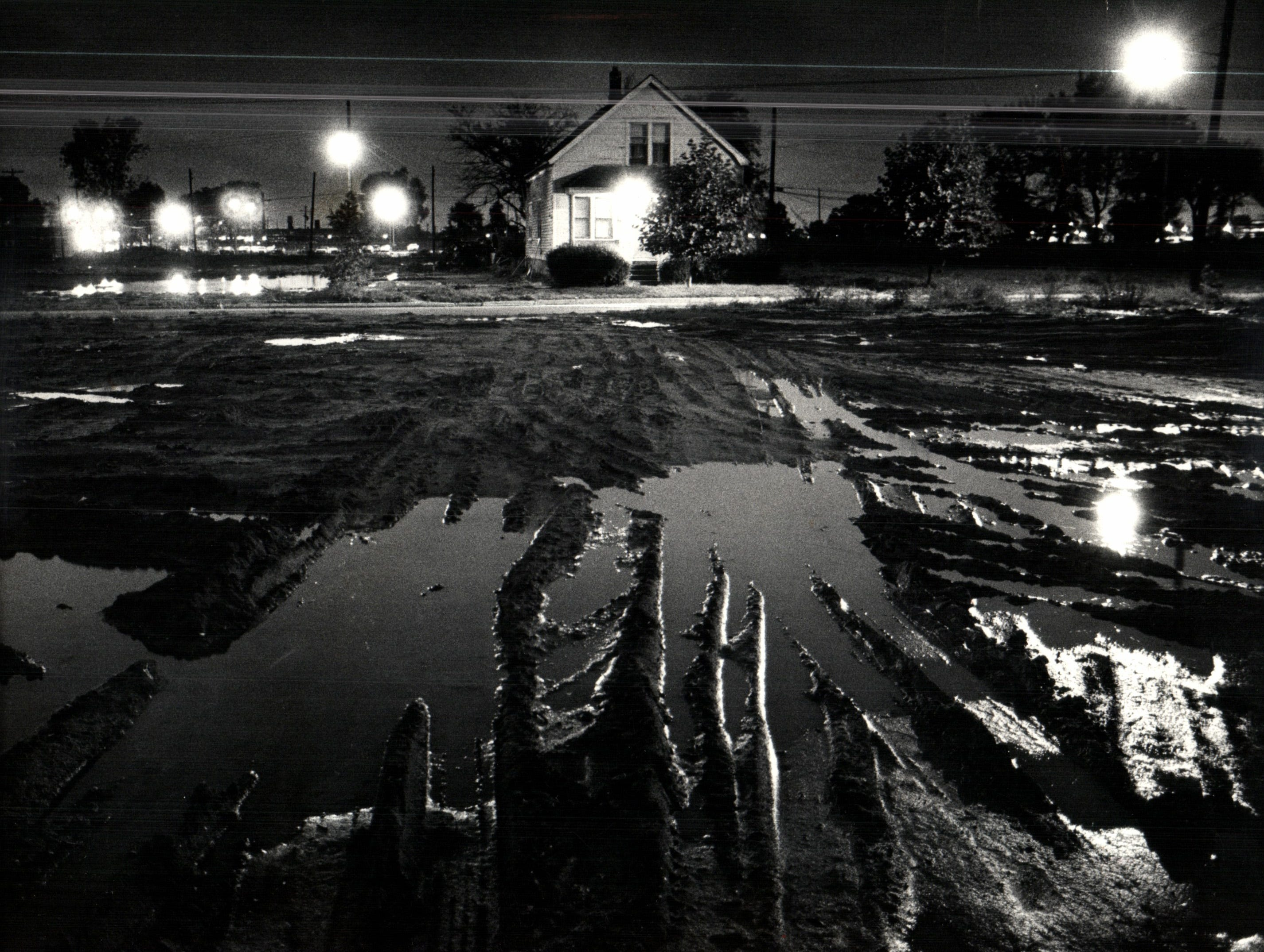 Barbara Sokol's house stood amid the muddy tracks of demolition equipment, an outpost of what once was. Barbara Sokol fought the change not only in her neighborhood, but downtown too, as part of a protest in front of Detroit Archdiocese headquarters on Washington Blvd. The archdiocese as one of a very diverse group of institutions, from the UAW to the Reagan administration, that decided, in essence, that Detroit needed a big new auto plant more than a small old neighborhood.