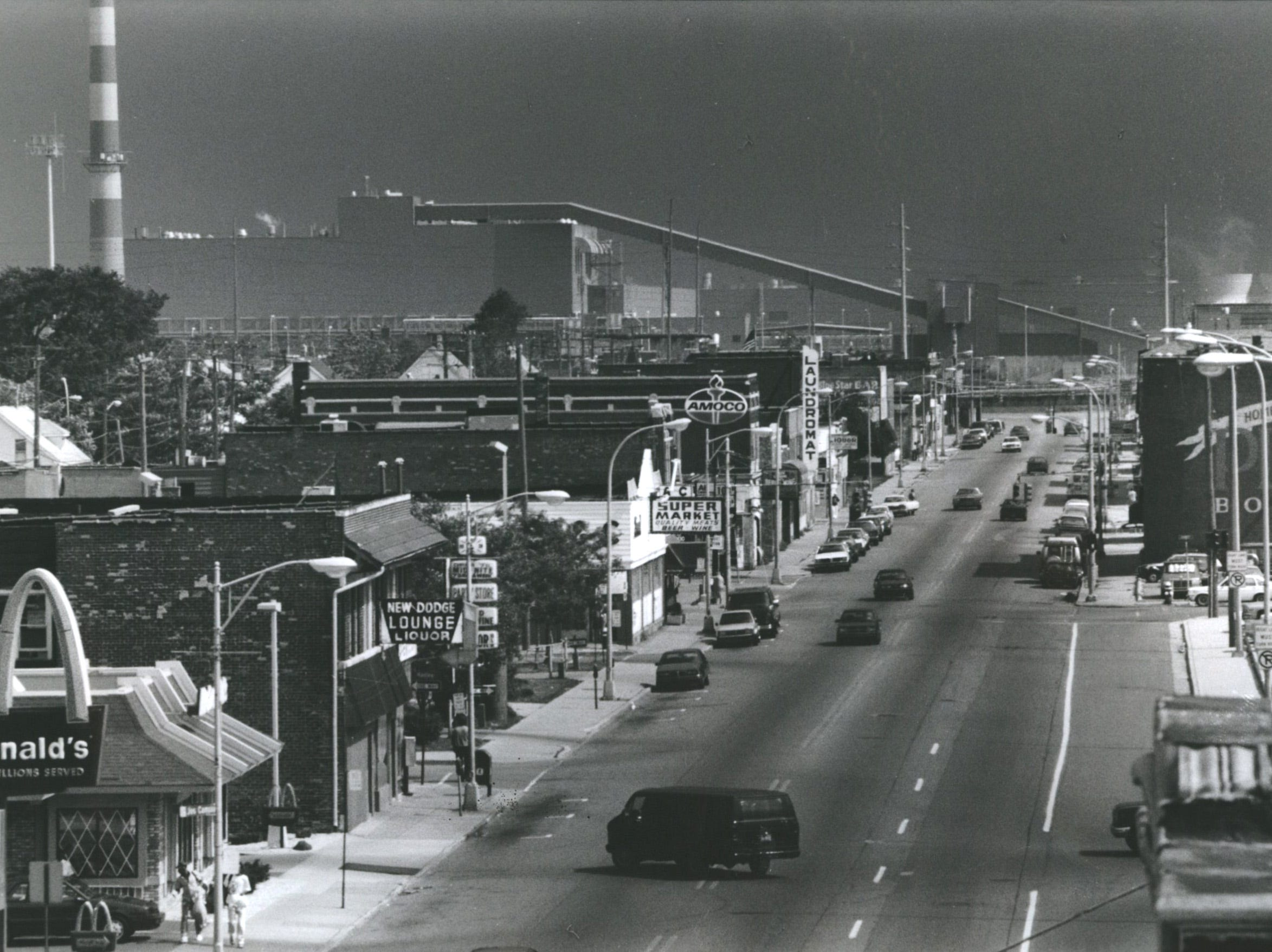 Hamtramck's main drag, Jos. Campau Avenue, looking south from Holbrook Street. General Motors' Poletown plant is on the horizon.