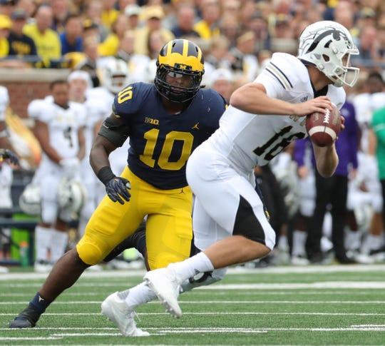 Michigan linebacker Devin Bush  Jr. pressures Western Michigan quarterback Jon Wassink on Sept. 8, 2018, at Michigan Stadium.