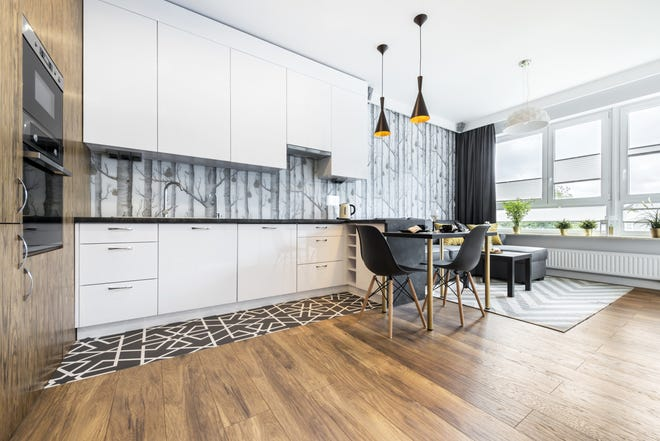 In 2019, we'll be mixing more natural-looking materials into our modern designs and hiding our appliances for a cleaner look. (Dreamstime)