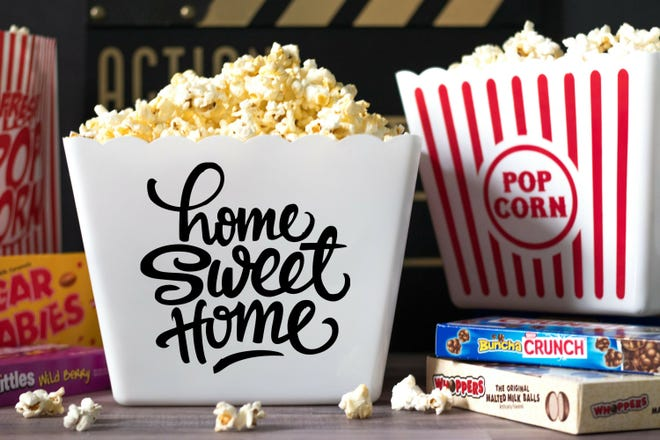 A welcome gift for a new neighbor can be as simple as a popcorn container with a sweet message.