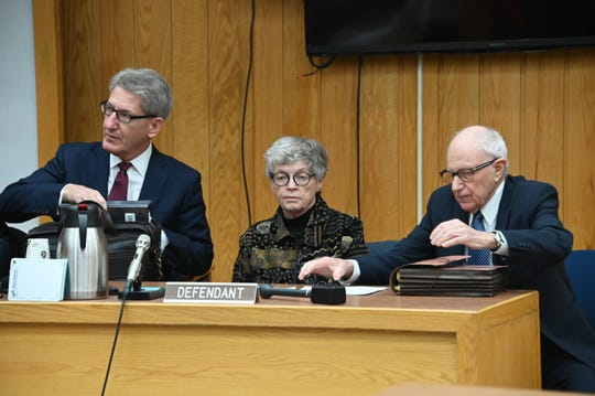 Former MSU President Lou Anna Simon, center, appears in court with her attorneys Monday in Charlotte.