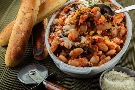 """The beans and the sauce for the pizza beans from """"Smitten Kitchen Every Day"""" by Deb Perelman can be made ahead, then mixed and baked at the party. Make sure to ask the host ahead for oven time. (Zbigniew Bzdak/Chicago Tribune/TNS)"""