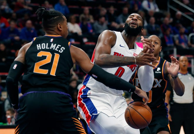 Phoenix Suns forward Richaun Holmes defends against Detroit Pistons center Andre Drummond on Sunday.