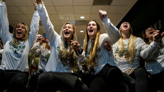 Eastern Michigan volleyball players celebrate seeing the school's name on the NCAA Tournament selection show Sunday night.
