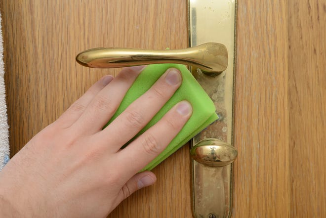 Doorknobs tend to harbor dirt and germs, so give them special attention when cleaning. (Dreamstime)