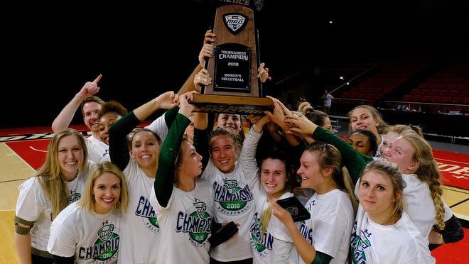 Eastern Michigan players celebrate their MAC tournament championship.