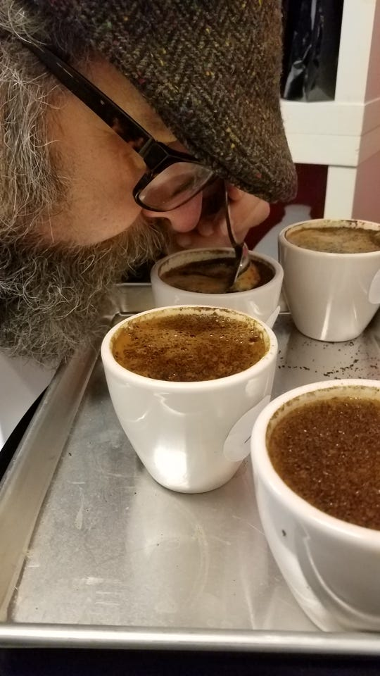Tim Piazza of Evansville Coffee Company  sniffs the aroma of four lighter-roasted beans from Guatemala, Costa Rica, Colombia and Ethiopia.