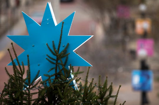 "A blue star tops the City of Evansville's Christmas tree. Sandwiched between the two blue stars are lights. The other side sports an ""e"" for ""everyone is welcome,"" according to the official press release."