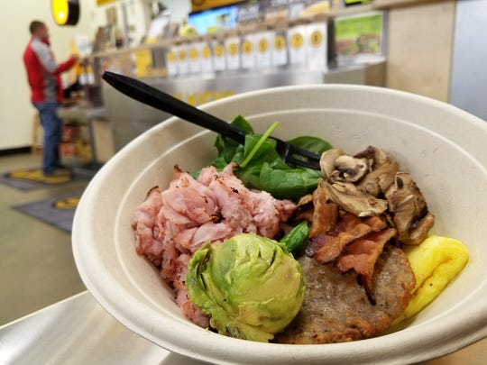 We enjoyed our Meat Lovers Breakfast in a bowl: Egg, sausage, bacon, cheese, and ham. We added spinach and avocado.