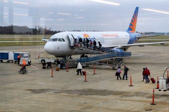 Travelers board an Allegiant Air flight departing to Orlando, Fla., at Evansville Regional Airport, Monday afternoon, Nov. 26, 2018.
