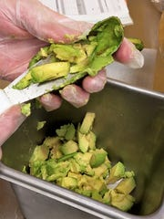 Fresh, ripe avocados are cut daily for adding to Which Wich sandwiches.