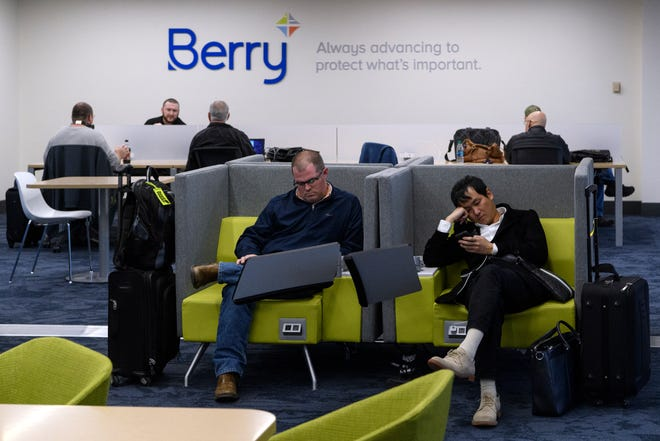Travelers use the new Berry Global Business Lounge area as they wait for their flights to begin boarding at Evansville Regional Airport, Monday afternoon, Nov. 26, 2018. It is open to the public and features several small conference rooms to accommodate travelers.