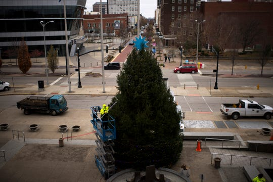 About 250,000 LED lights will adorn the 28-foot-tall Norway spruce outside the Civic Center when the Traffic Engineering Department finishes hanging them. The City of Evansville's annual Christmas Tree lighting ceremony will take place Wednesday night at 5 p.m. and the Reitz Memorial High School Choir will perform. The tree was donated by Richard Sanford.