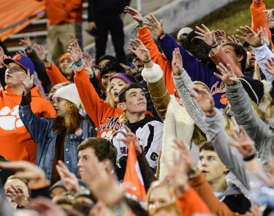 A South Carolina fan stands among Clemson fans before the South Carolina at Clemson football game in Clemson on Saturday, November 24, 2018.