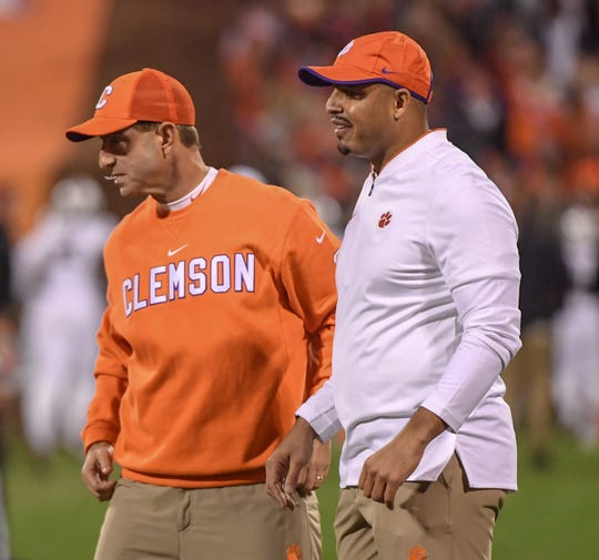 Clemson Head Coach Dabo Swinney, left, and co-offensive coordinator Tony Elliott during warm ups before the game with South Carolina in Memorial Stadium on Saturday, November 24, 2018.