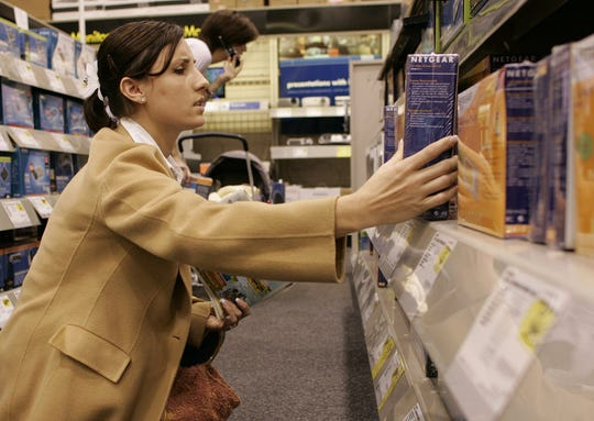 Marie Dunn shops for holiday gifts at Best Buy in Greenville on Nov. 24, 2004.