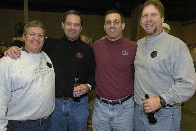 Great Falls natives and Griz fans, from left, Mark Webb, Bruce Carlson, Grant Kleckner and Mike Roban attend the football rally Thursday, Dec. 16, 2004, in Chattanooga, Tenn. Carlson died on Thanksgiving morning from complications of throat cancer. He was 62.