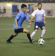 The Sidekicks' Shaine Munoz attempts to move the ball past Guam Shipyard's Donald Weakley in a Week 7 match of the Budweiser Soccer League Premier Division Nov. 24 at the Guam Football Association National Training Center. The Sidekicks defeated Guam Shipyard 4-0.