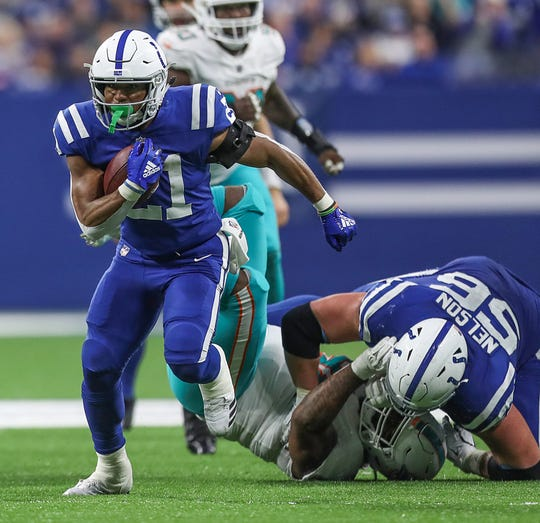 Indianapolis Colts running back Nyheim Hines (21) carries the ball and earns the first down during the second half of the game at Lucas Oil Stadium in Indianapolis, Sunday, Nov. 25, 2018. The Colts won, 27-24.