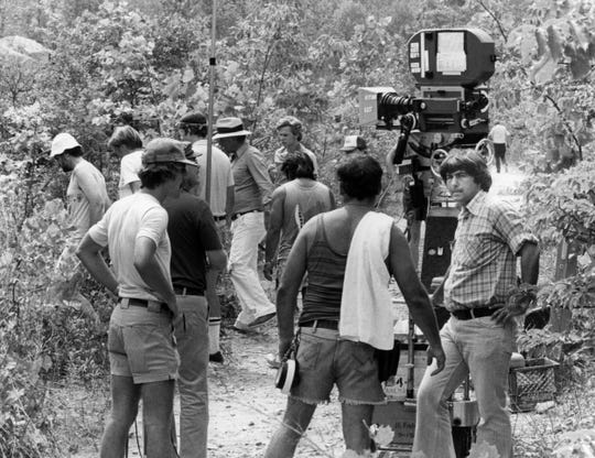 """Breaking Away"" cast and crew during the filming in September 1978. Director Peter Yates (in Panama hat) is followed by actor and star Dennis Christopher during filming at the quarry."