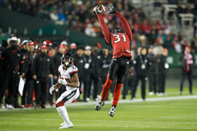 Calgary Stampeders defensive back Tre Roberson (31) knocks down a pass intended for Ottawa Redblacks wide receiver Diontae Spencer (85) during the first half of the 106th Grey Cup in Edmonton, Alberta, Sunday, Nov. 25, 2018.