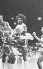 Washington's Joseph Reed (32) and Darius Jenkins  go up against Ken Barlow of Cathedral (34) on  March 15, 1982.