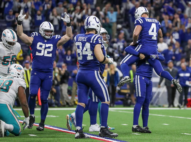Indianapolis Colts kicker Adam Vinatieri (4) celebrates after scoring the 32-yard game-winning field goal against the Miami Dolphins in the fourth quarter of the game at Lucas Oil Stadium in Indianapolis, Sunday, Nov. 25, 2018. The Colts won, 27-24.
