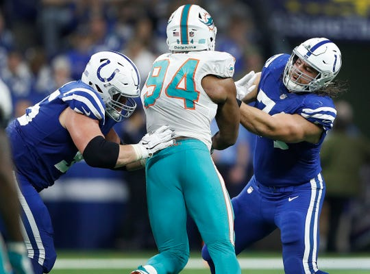 Indianapolis Colts offensive tackle Anthony Castonzo (74) and  offensive guard Quenton Nelson (56) stops the pass rush by Miami Dolphins defensive end Robert Quinn (94) in the second half of their game at Lucas Oil Stadium on Sunday, Nov. 25, 2018. The Colts defeated the Dolphins 27-24.