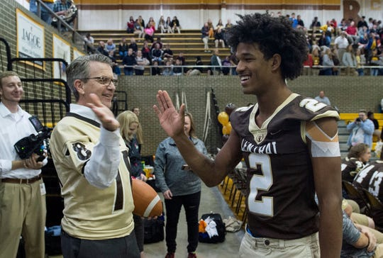 Evansville Mayor Lloyd Winnecke high-fived Central's Malcolm DePriest during a pep rally on Nov. 23. Winnecke is a Central alum.