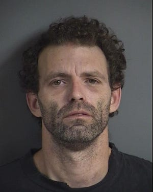 Joshua David Liles, 36, is being held at the Johnson County Jail after he was arrested Saturday, Nov. 24, on domestic abuse assault charges.