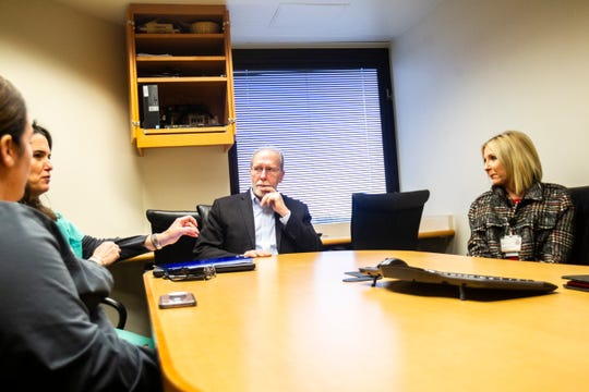 U.S. Rep. Dave Loebsack, D-Iowa, and Jennifer Harbison (far right) listen to Dr. Jodi Tate (second from left) on Monday, Nov. 26, 2018, at the University of Iowa Hospital Crisis Stabilization Unit in Iowa City.