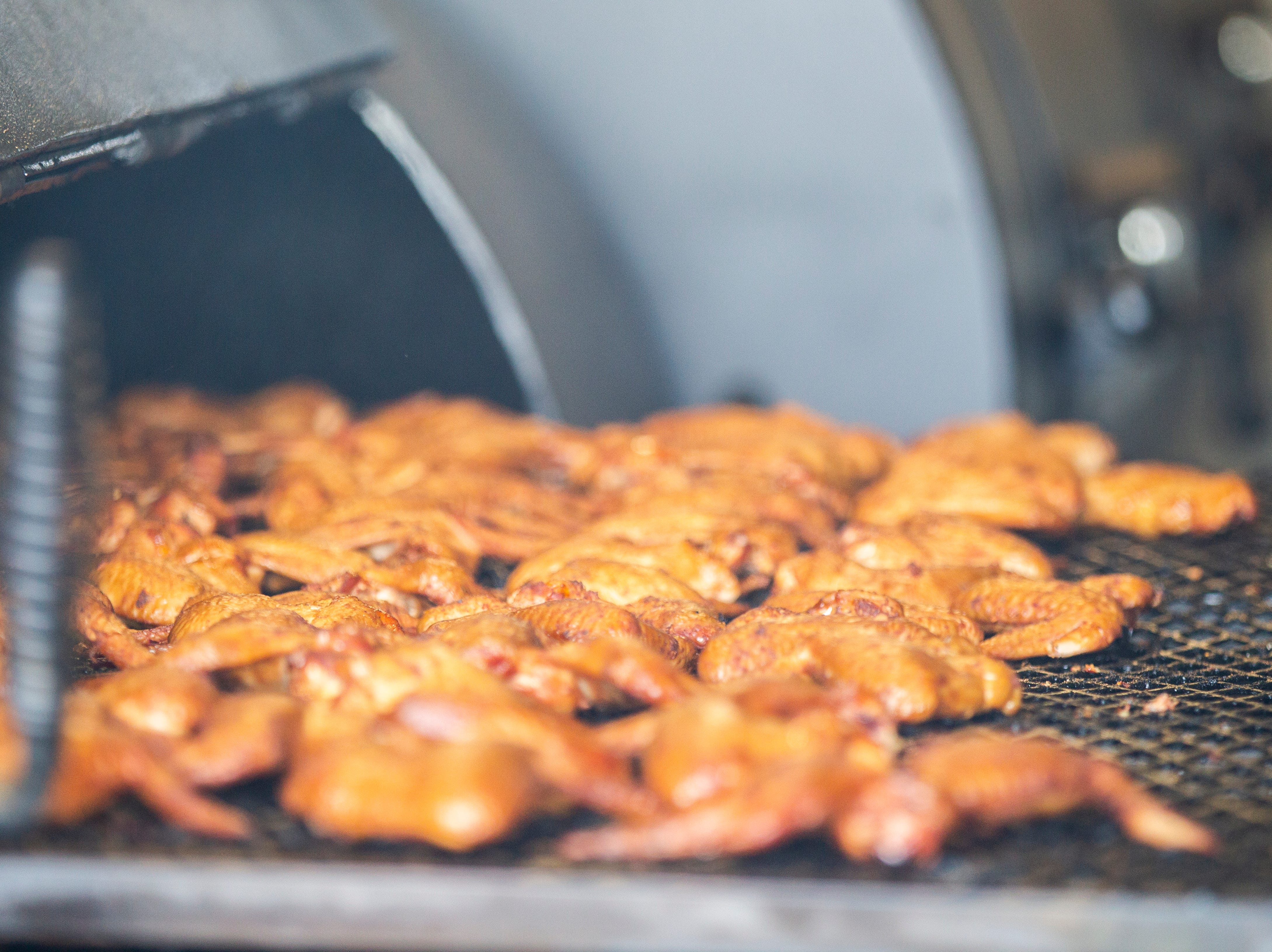 Chicken wings are seen in a smoker on Wednesday, Nov. 21, 2018, at Mosley's Barbecue and Provisions in North Liberty.