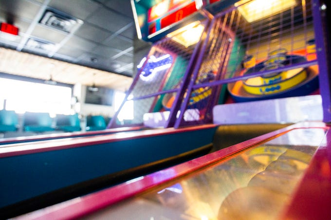 A Skee-Ball machine is seen in a game room on Wednesday, Nov. 21, 2018, at Mosley's Barbecue and Provisions in North Liberty.