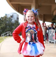 Laci Lamb, 9,  of Lucedale, Miss., waits in line to see President Donald Trump speak at a rally at the Mississippi Coast Coliseum and Convention Center on Nov. 26, 2018.