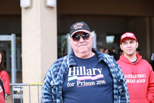 Mitch Maggio of Pass Christian, Miss, is part of a crowd waiting to see President Donald Trump speak at a rally at the Mississippi Coast Coliseum and Convention Center on Nov. 26, 2018, in support of U.S. Senate candidate Cindy Hyde-Smith.