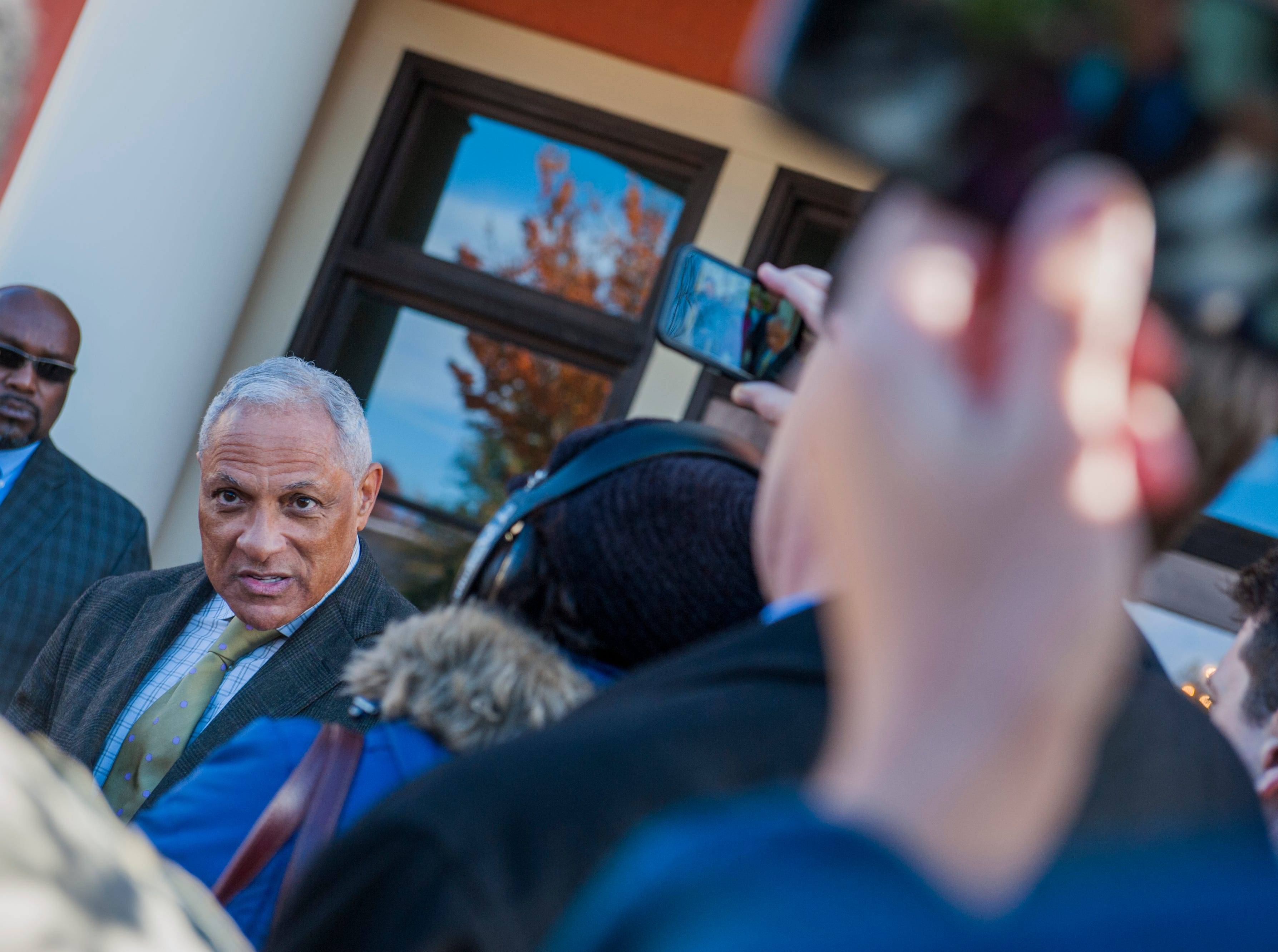 Senate candidate Mike Espy answers questions from media outside Local 463 in Ridgeland Monday, Nov. 26, after he and his wife, Portia, stopped by the restaurant for lunch. Voters head to the polls Tuesday, Nov. 27, for a runoff to see who will serve the final two years of retired Sen. Thad Cochran's term, Espy or Cindy Hyde-Smith.