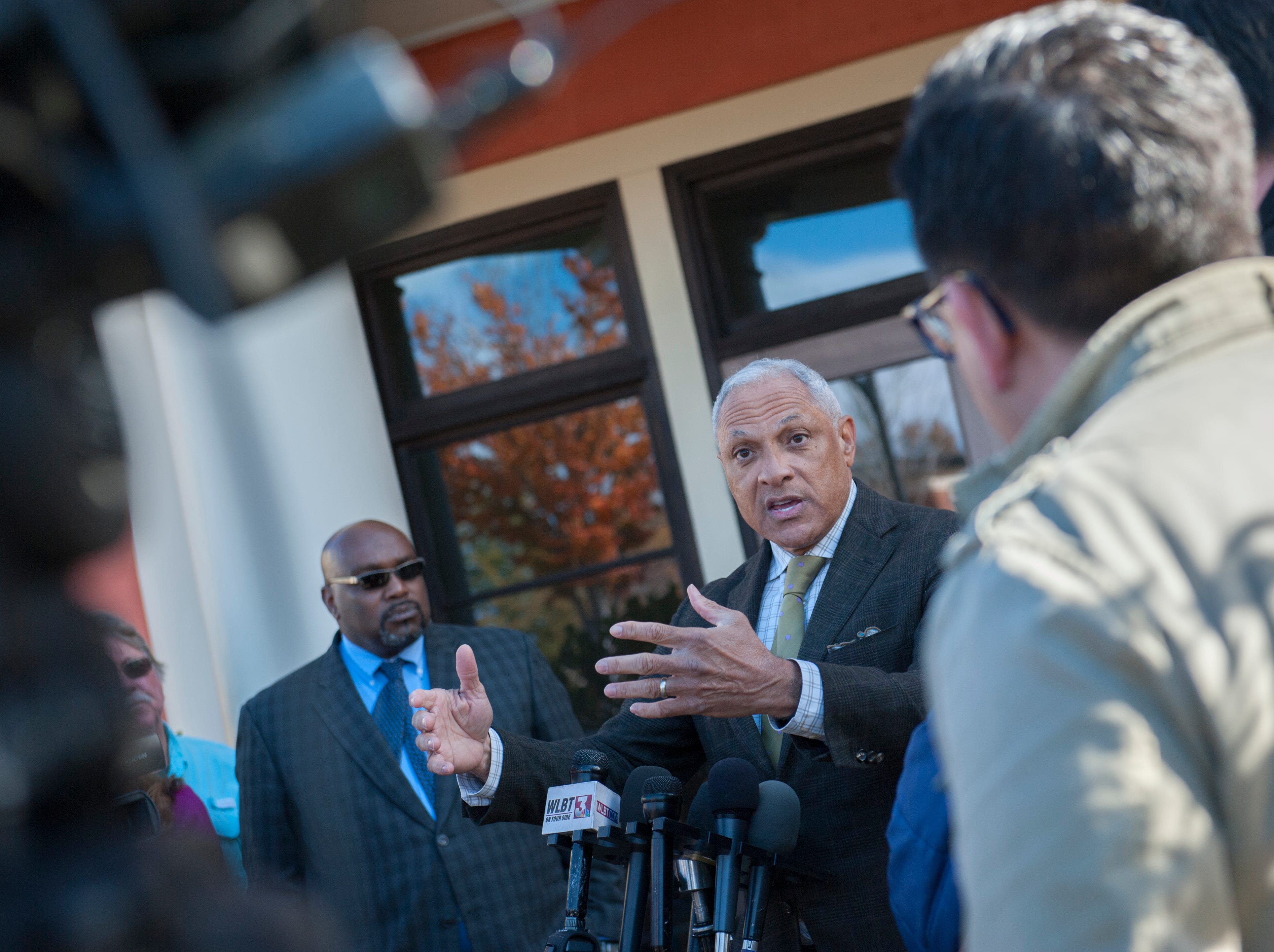 Senate candidate Mike Espy answers questions from media outside Local 463 in Ridgeland, Miss. Monday, Nov. 26, after he and his wife, Portia, stopped by the restaurant for lunch. Voters head to the polls Tuesday, Nov. 27, for a runoff to see who will serve the final two years of retired Sen. Thad Cochran's term, Espy or Cindy Hyde-Smith.