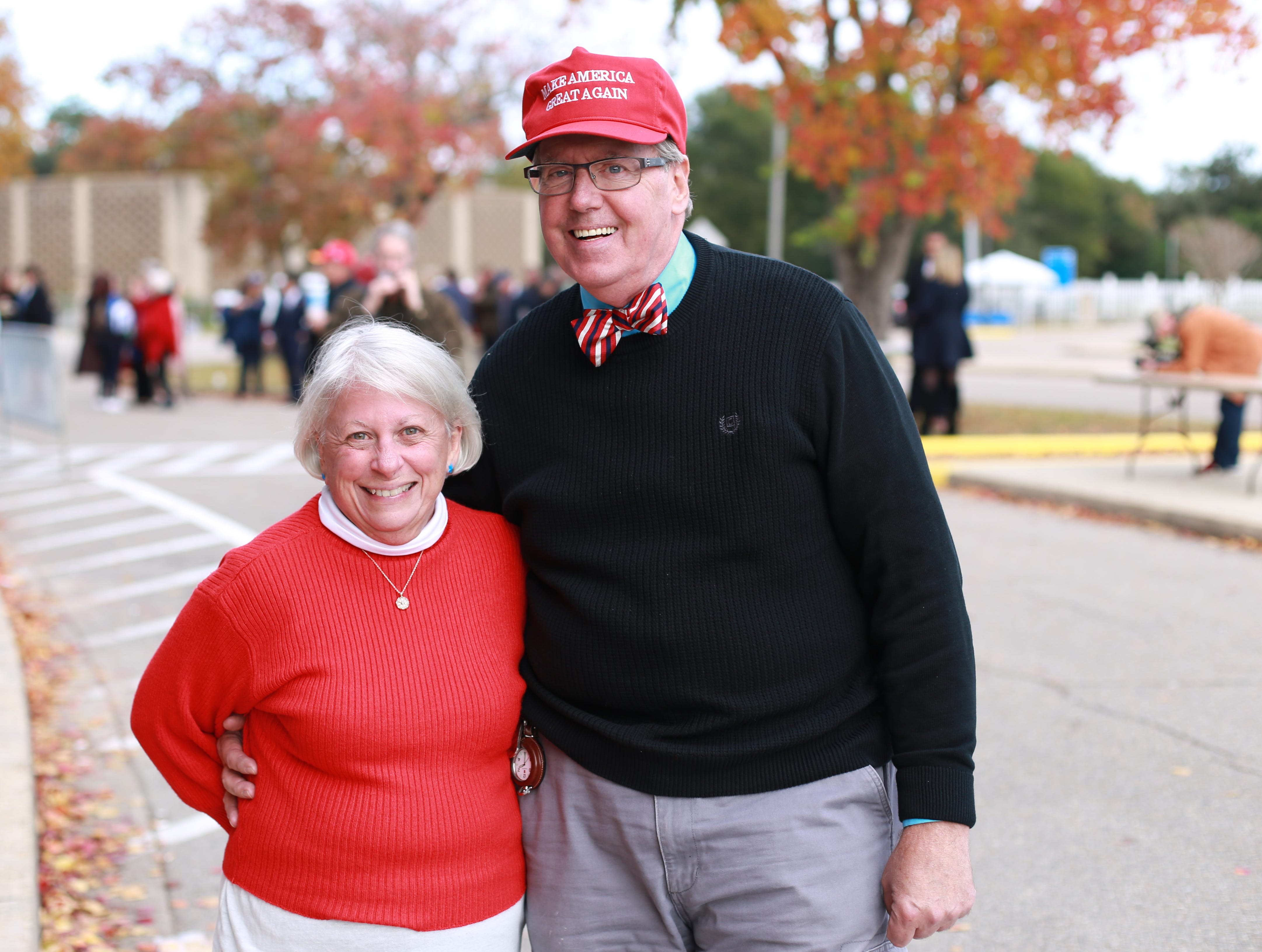 Virginia and James Olander of Bay St. Louis, Miss., are part of a crowd waiting see President Donald Trump speak at a rally at the Mississippi Coast Coliseum and Convention Center on Nov. 26, 2018, in support of U.S. Senate candidate Cindy Hyde-Smith.