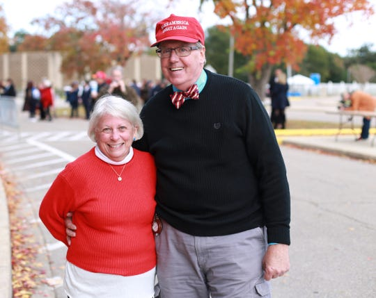 Virginia and James Olander of Bay St. Louis, Miss., are part of a crowd waiting to see President Donald Trump speak at a rally at the Mississippi Coast Coliseum and Convention Center on Nov. 26, 2018, in support of U.S. Senate candidate Cindy Hyde-Smith.
