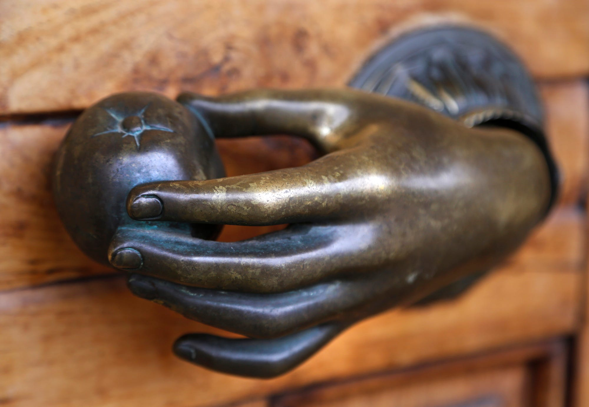The distinctive door knob of Interior Objects Monday, November 26, 2018, at 2200 Elmwood Avenue, Suite A4, in the Market Square Shopping Center. Interior Objects announced on its Facebook page that it would be closing its doors. A liquidation sale will begin Thursday, November 29 at 10 a.m.