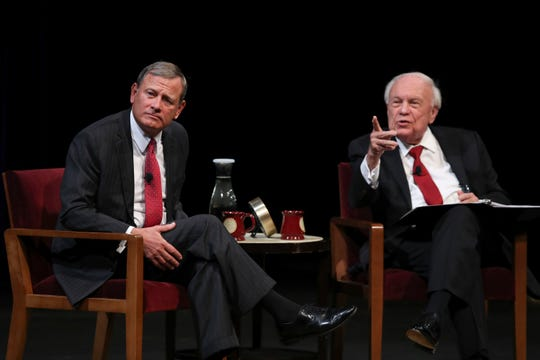 U.S. Supreme Court Chief Justice John Roberts, Jr., left, listens to a student's question following his conversation with Professor Robert A. Stein during the University of Minnesota Law School's 2018 Stein Lecture at Northrop Auditorium in Minneapolis on Tuesday, Oct. 16, 2018.