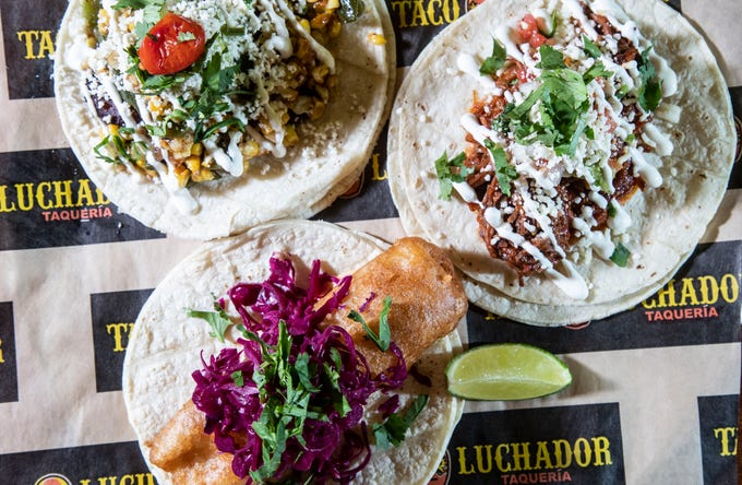 Three tacos from Taco Luchador: The Barbacoa with braised short ribs, Baja Fish that has Mexican beer battered and Veggie. Some of the ingredients include poblanos, guacamole, pickled cabbage and crema.