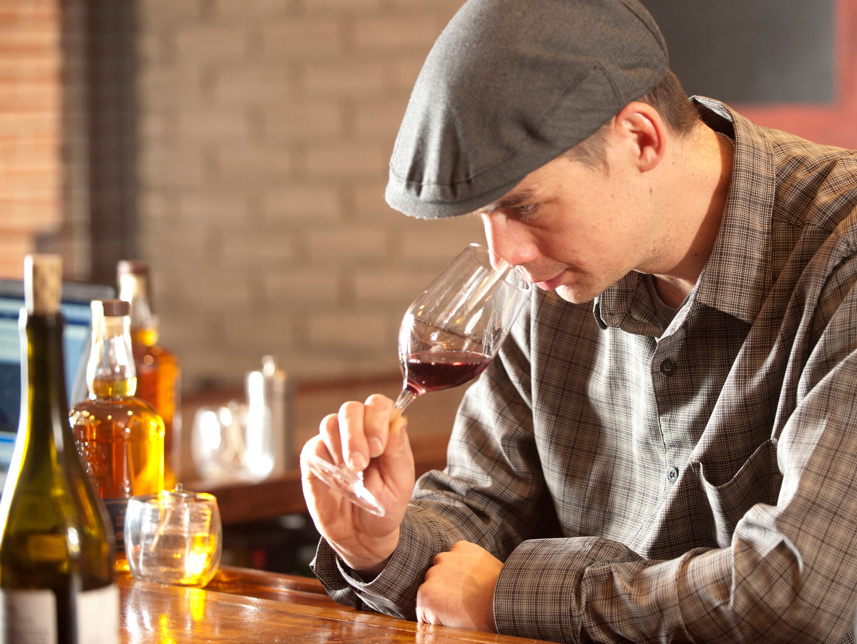 Isaac Fox, owner of the La Chasse Restaurant on Bardstown Road, test out a new wine.November 15, 2018