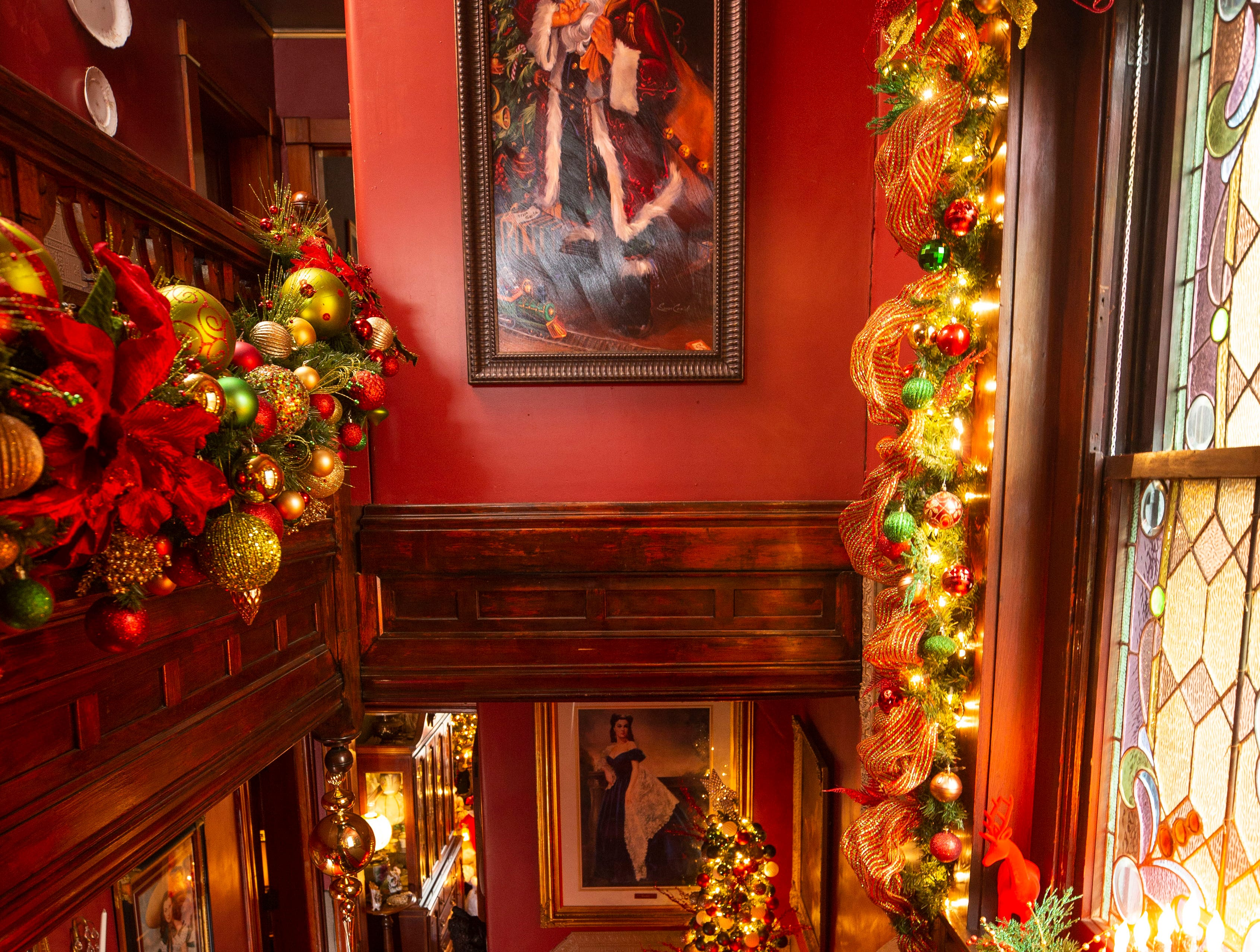 David Brown spends about 20 to 30 hours a week decorating the 6,000-square foot, three-story home, including the stairs with more than 7,000 ornaments.