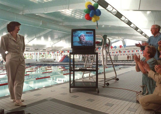 The pool was named for Mary T. Meagher during a dedication ceremony in 1998, where Meagher, left, stood near a television monitor showing one of her Olympic performances.