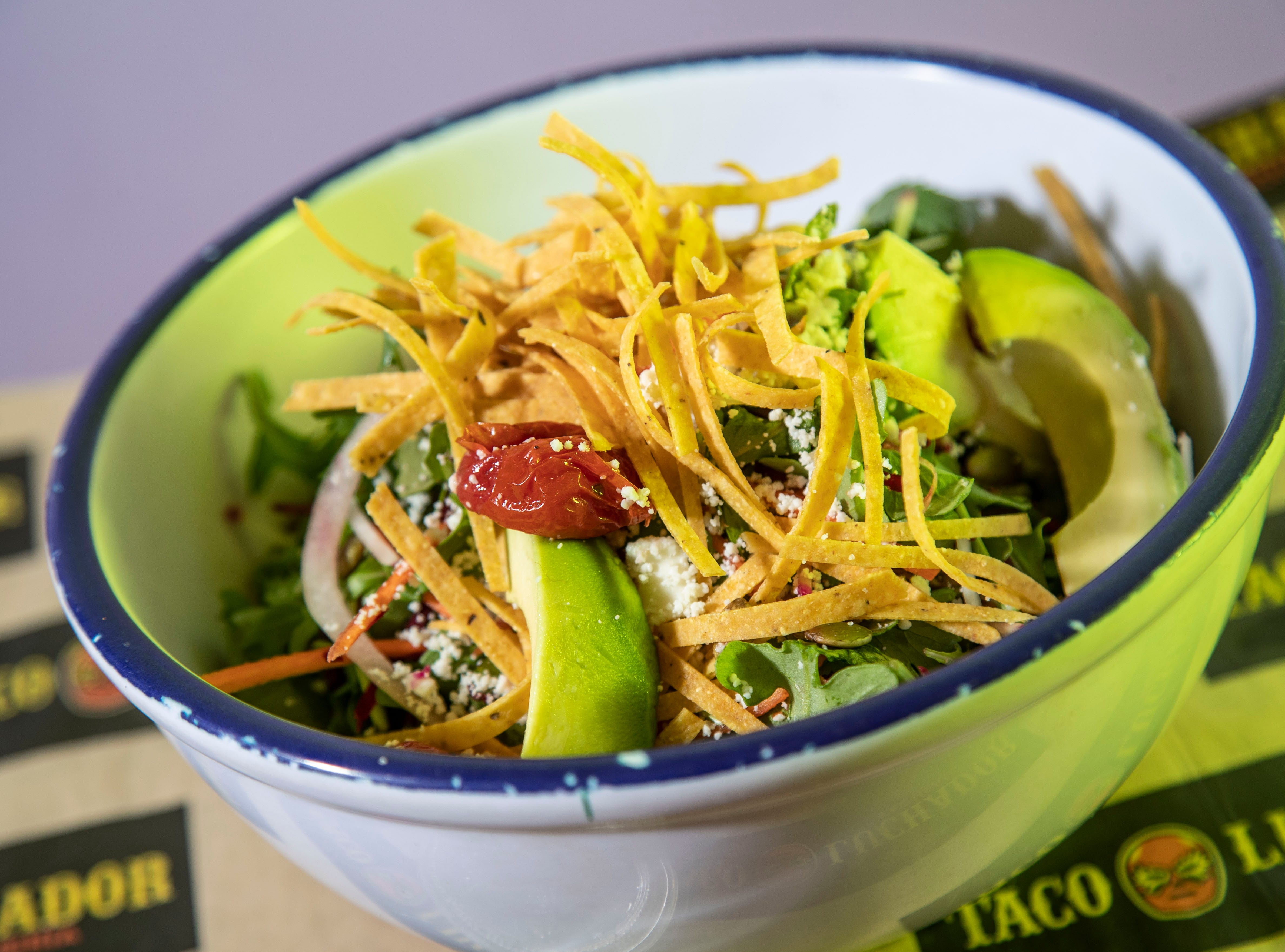 The Crunchy Mexican from Taco Luchador includes roasted cherry tomatoes, pickled red cabbage, carrots, onions, avocado, cilantro, beets, lime-cilantro agave vinaigrette, arugula, queso fresco with crispy tortilla strips and pumpkin seeds.