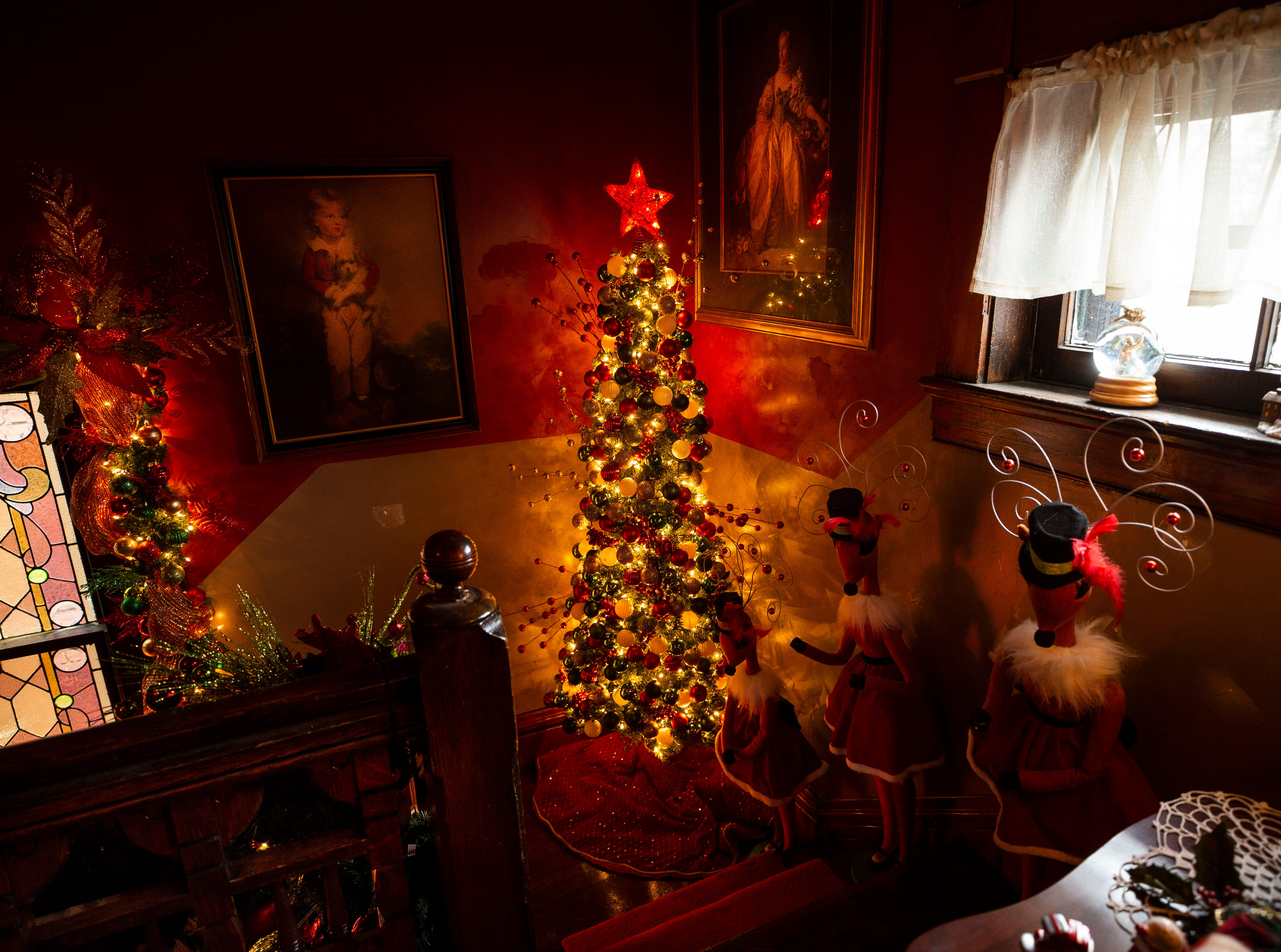 """David Brown spends about 20 to 30 hours a week decorating the 6,000-square foot, three-story home, including the stairs with more than 7,000 ornaments. ItÕs fun, itÕs exhausting, but itÕs well worth it,"""" he said, who gets help from cousins and friends."""