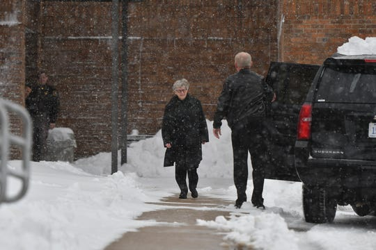 Former MSU President Lou Anna Simon leaves the Eaton County Courthouse via the backdoor Monday, Nov. 26, 2018, after her arraignment on four charges of lying to police related to the Larry Nassar investigation.  [AP Photo/Matthew Dae Smith/Lansing State Journal]