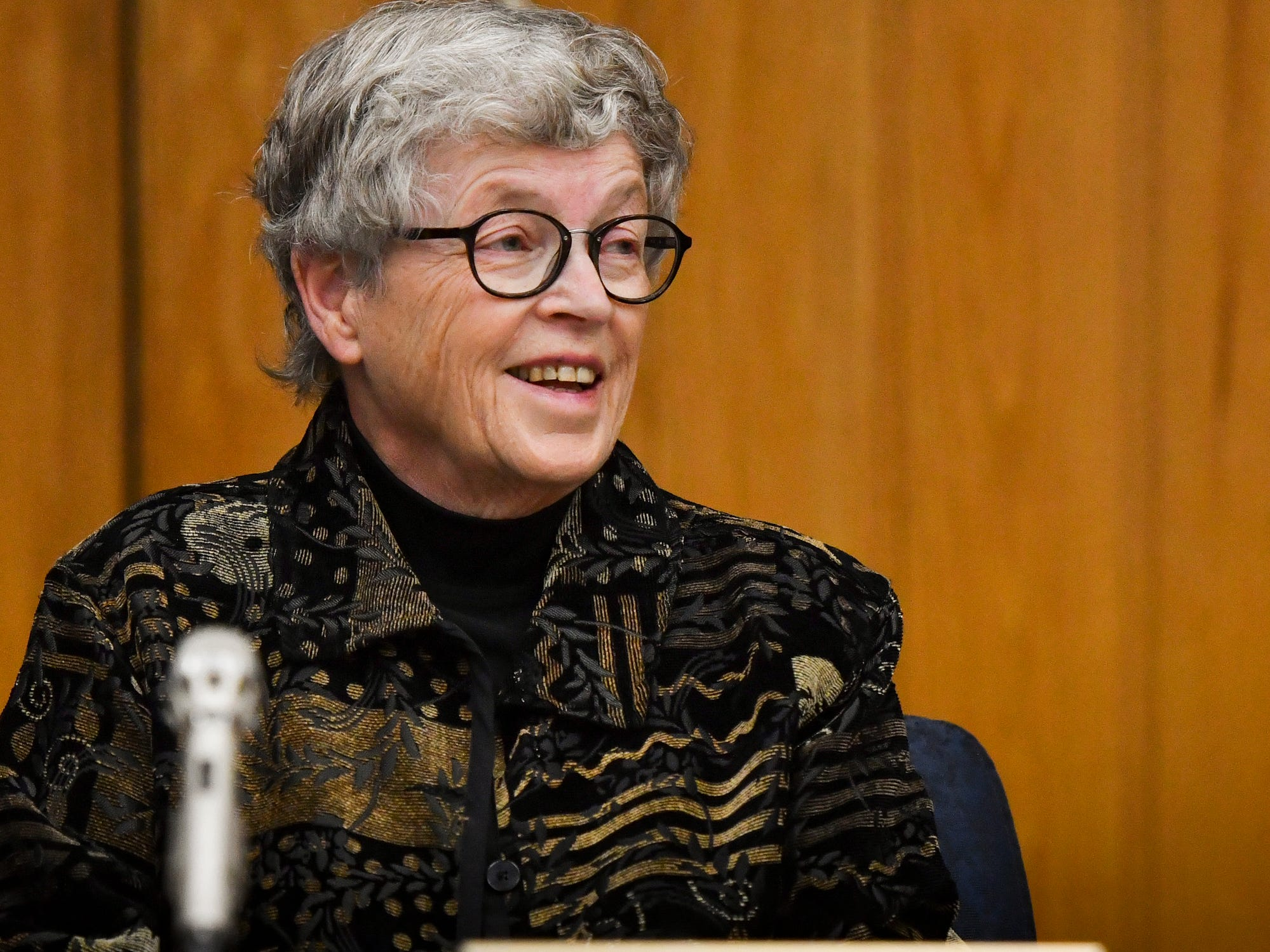 Former MSU President Lou Anna Simon smiles because of scheduling conflicts between the prosecution and defense for her upcoming preliminary exam during her arraignment in Judge Julie Reincke's Eaton County Court Monday, Nov. 26, 2018.  She was arraigned on four charges of lying to police related to the Larry Nassar investigation.  [AP Photo/Matthew Dae Smith/Lansing State Journal]
